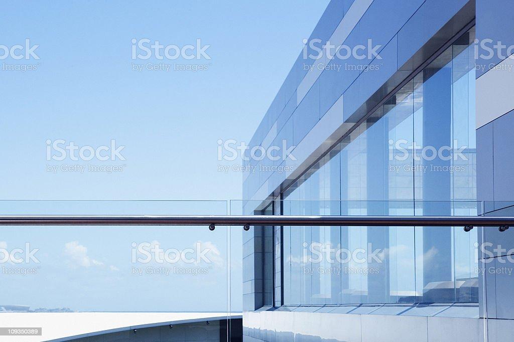 Glass railing on modern building balcony stock photo