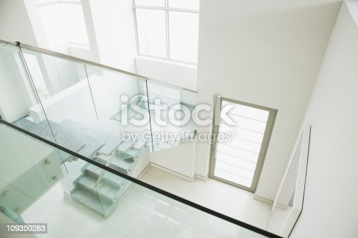 istock Glass railing on staircase in modern house 109350263
