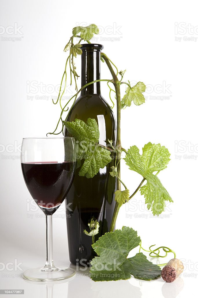 Glass red wine and bottle with grape´s leafs stock photo