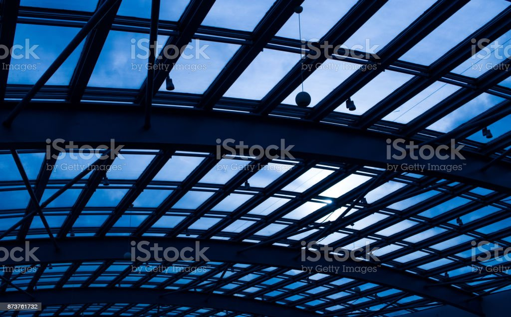Glass Roof Against Blue Sky And Sun Shine stock photo
