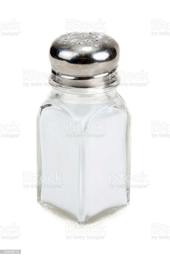 Glass salt shaker filled with salt on a white background stock photo