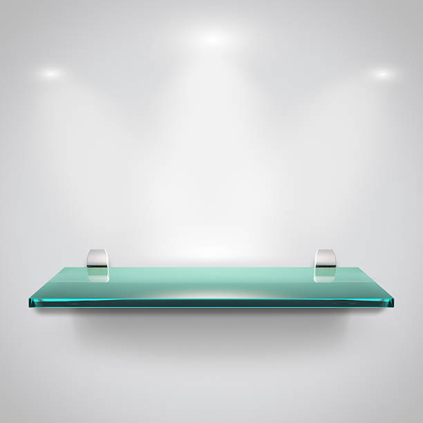 Glass shelves with spot light stock photo