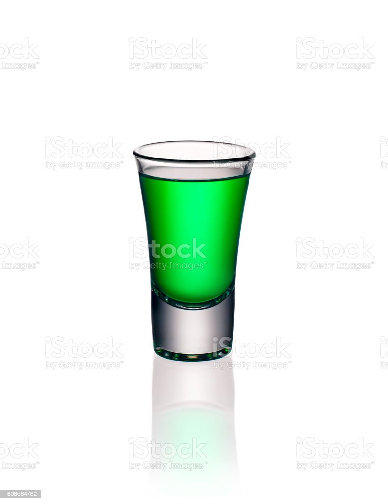 Glass shot with green absinthe isolated stock photo