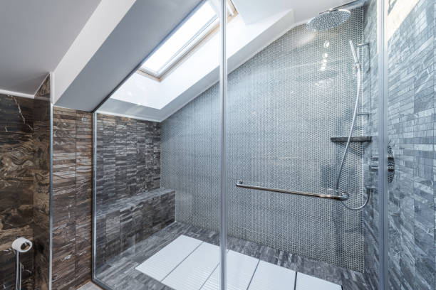 Glass shower cabin in modern loft bathroom stock photo