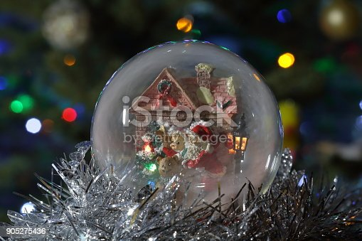 istock Glass snow globe with Santa Claus and lantern. Christmas toy 905275436