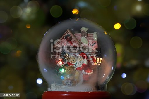 istock Glass snow globe with Santa Claus and lantern. Christmas toy 905275742