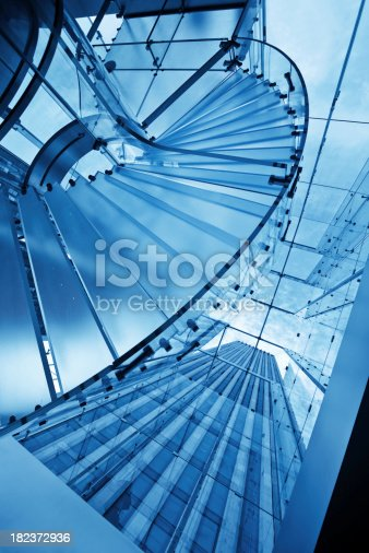 blue toned glass staircase