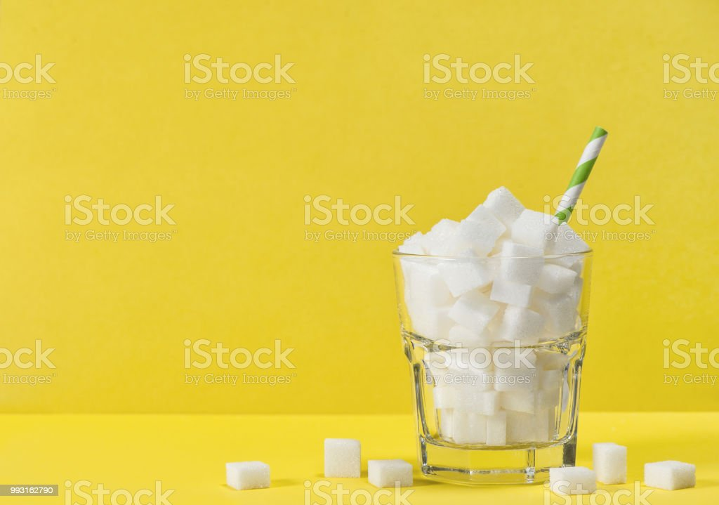 Glass sugar cubes Weight control diet health detox concept royalty-free stock photo