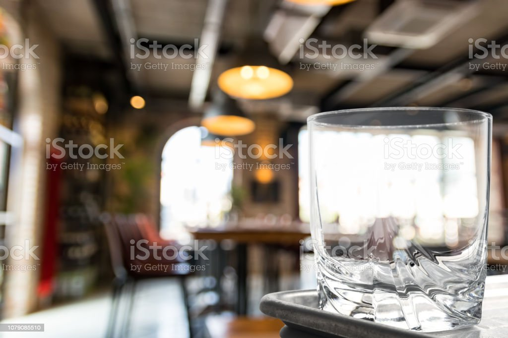 Glass tumbler with still life pattern on a silver tray. stock photo
