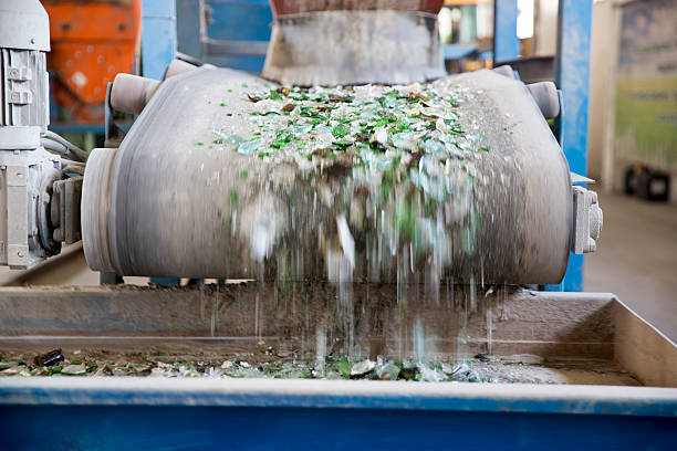 glass waste in recycling facility. glass particles - altglas stock-fotos und bilder