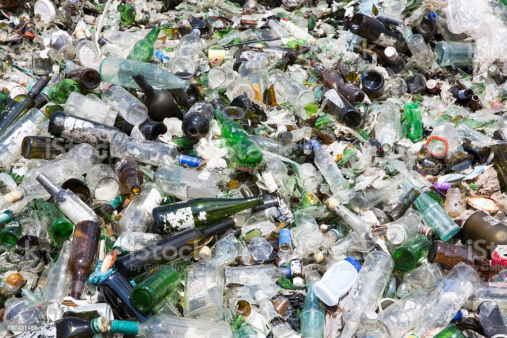 Glass waste in recycling facility. Pile of bottles. stock photo