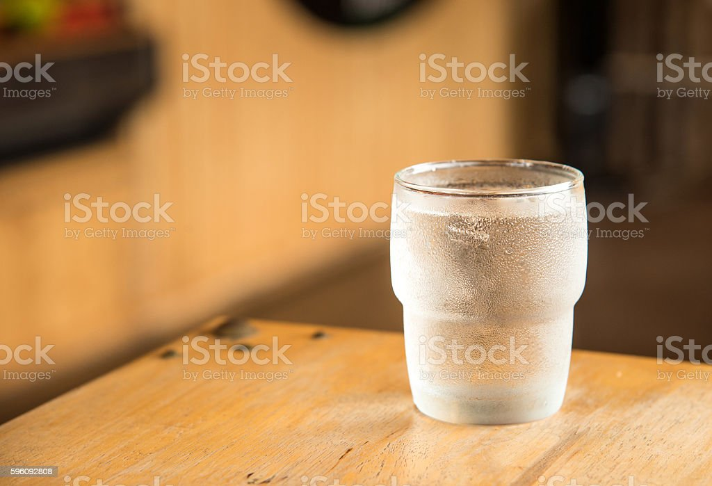 Glass water on wooden table. royalty-free stock photo