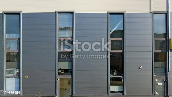 178842131 istock photo Glass windows and doors in the modern office  building 1246864541