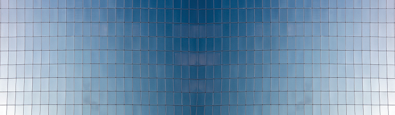 Glass windows of skyscrapers, texture. Matte surface not reflecting the sky. Texture