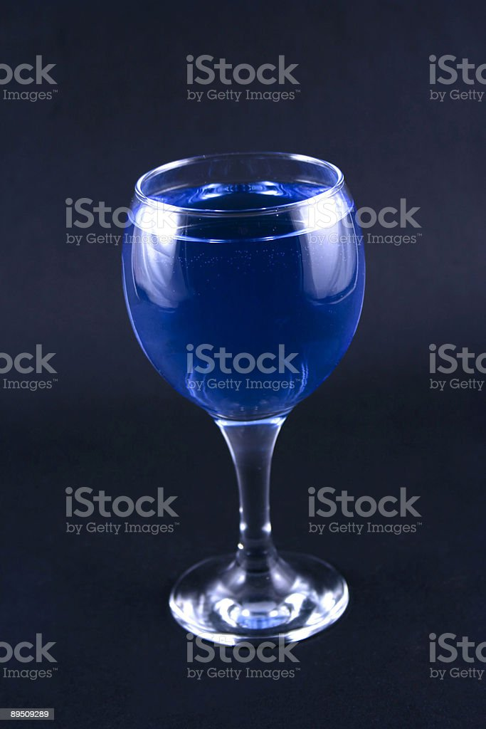 Glass with a blue drink royalty-free stock photo