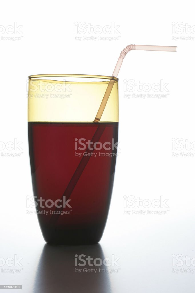 Glass with a red liquid royalty-free stock photo