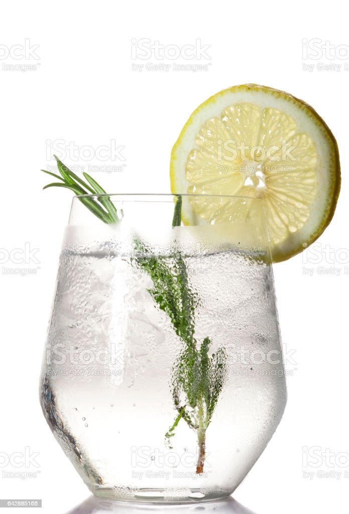 Glass with alcoholic drink with lime and ice stock photo