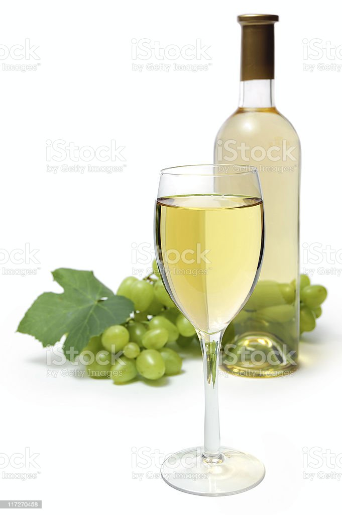 Glass with bottle and grape cluster on background royalty-free stock photo