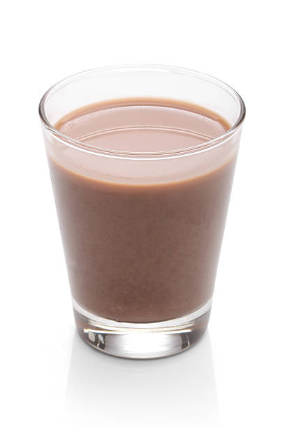 Glass with chocolate milk, over white Glass with chocolate milk, over white, with clipping path chocolate milk stock pictures, royalty-free photos & images