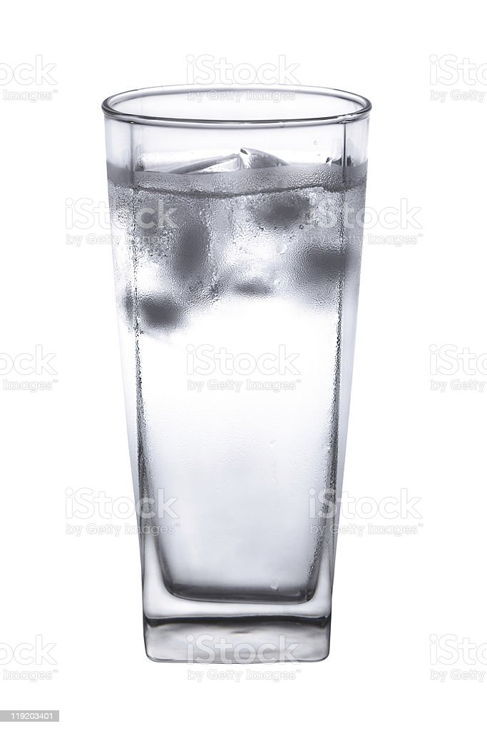 Glass with clear water and ice cubes. stock photo