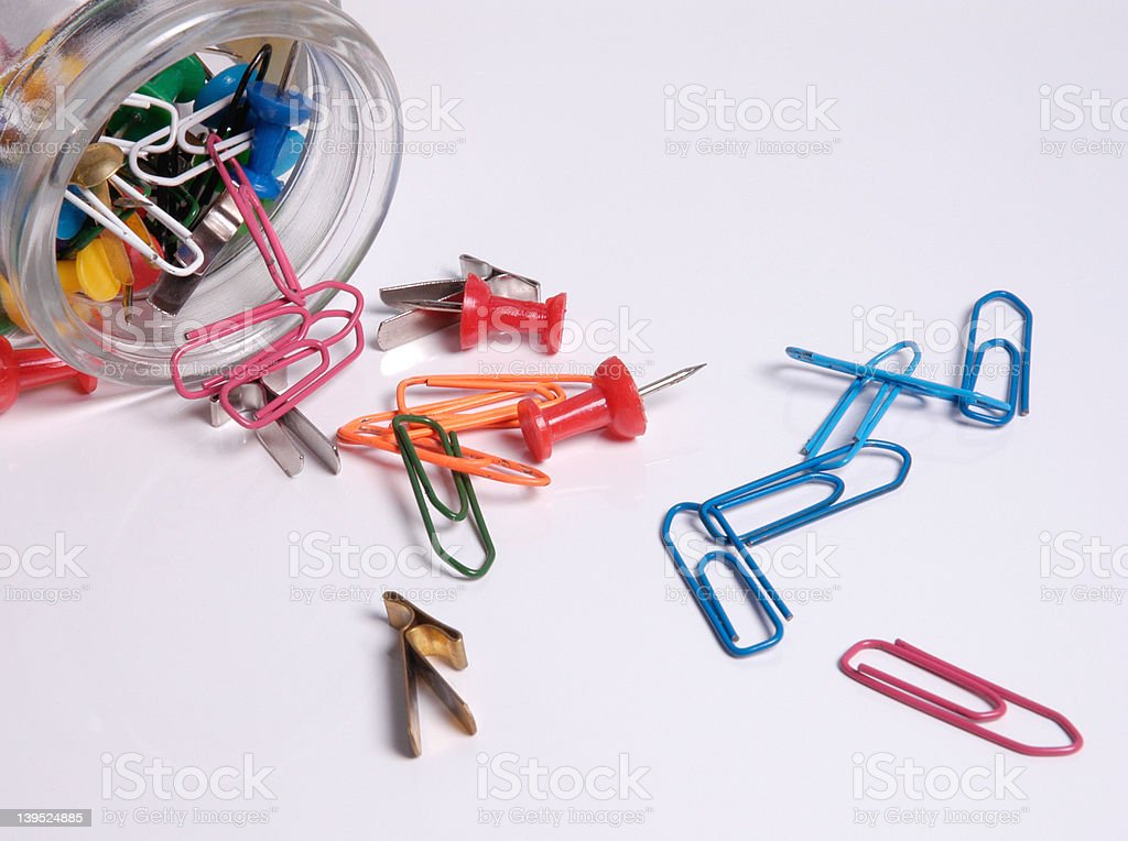 glass with clips and pins stock photo