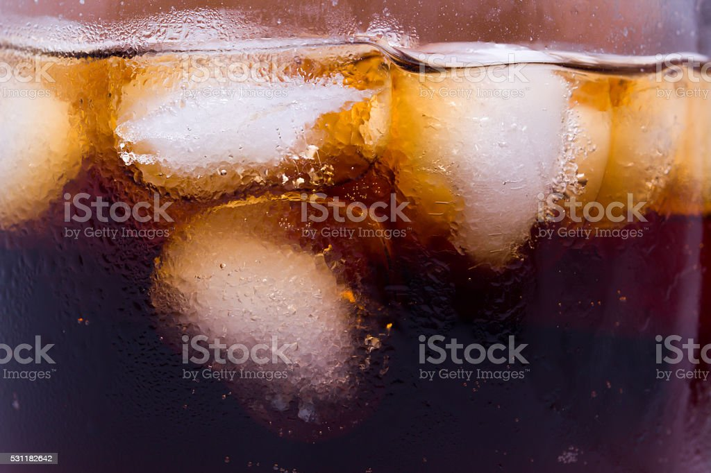 Glass with Coca and ice on a stock photo