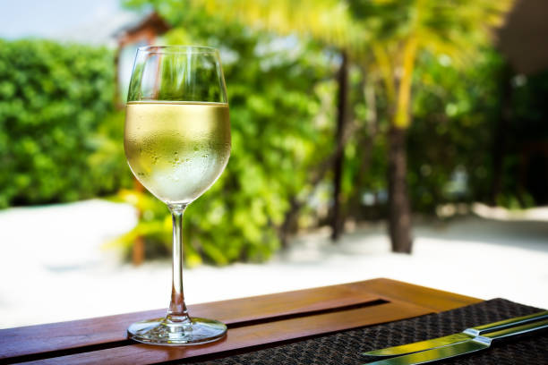 Glass with cold white wine stock photo