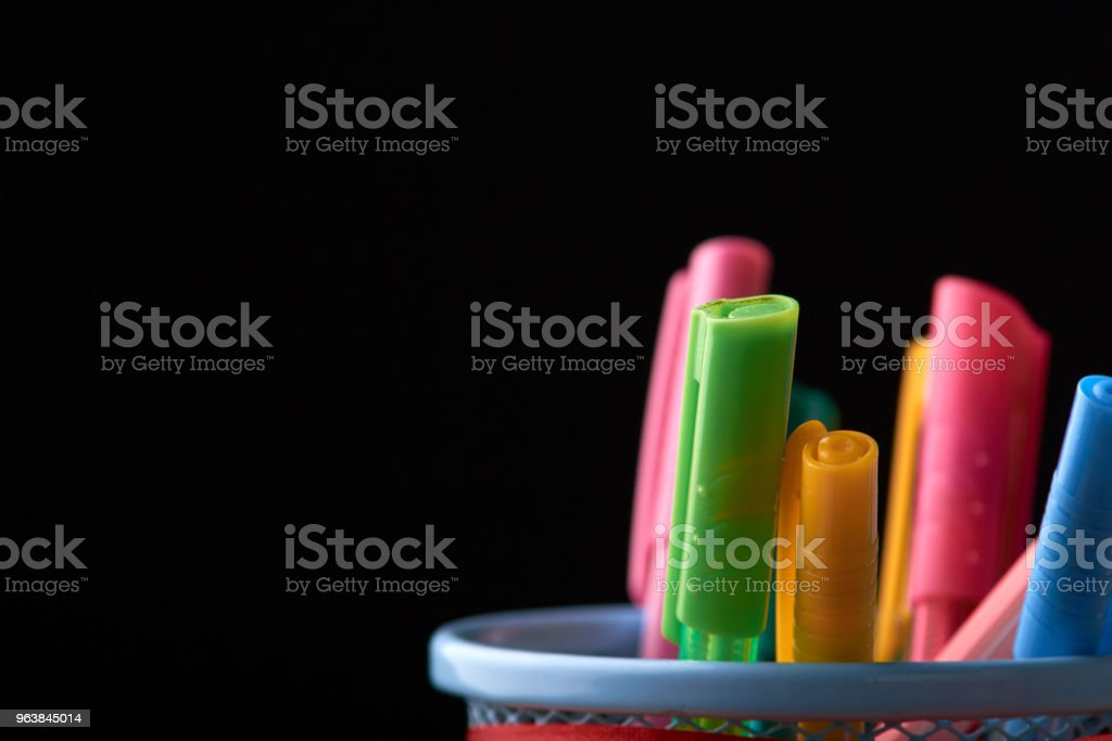 A glass with colored pens. Stationery set. Concept: back to school - Royalty-free Abstract Stock Photo
