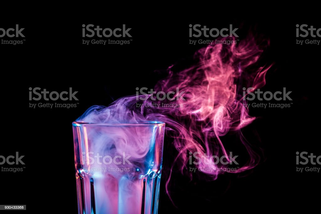 A glass with colorful smoke stock photo