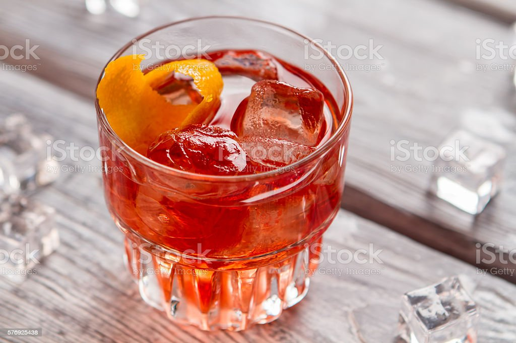 Glass with dark orange drink. stock photo