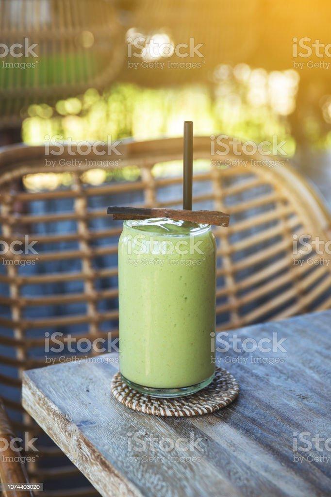 Glass with delicious avocado smoothie stock photo