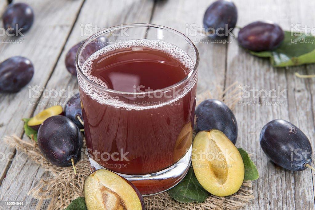 Glass with fresh Plum Juice stock photo