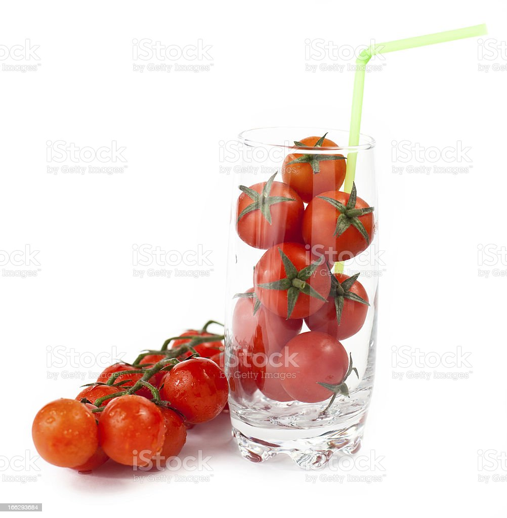 Glass with fresh tomatoes royalty-free stock photo