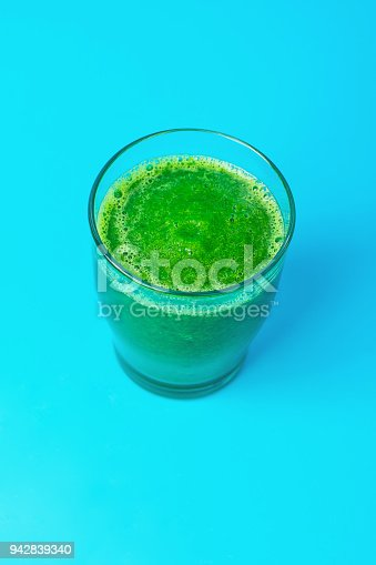 istock Glass with Green Fresh Raw Smoothie from Leafy Greens Vegetables Fruits Spinach Apples Bananas Kiwi Zucchini on Light Blue Background. Healthy Lifestyle Detox Vitamins Energy Freshness Concept 942839340