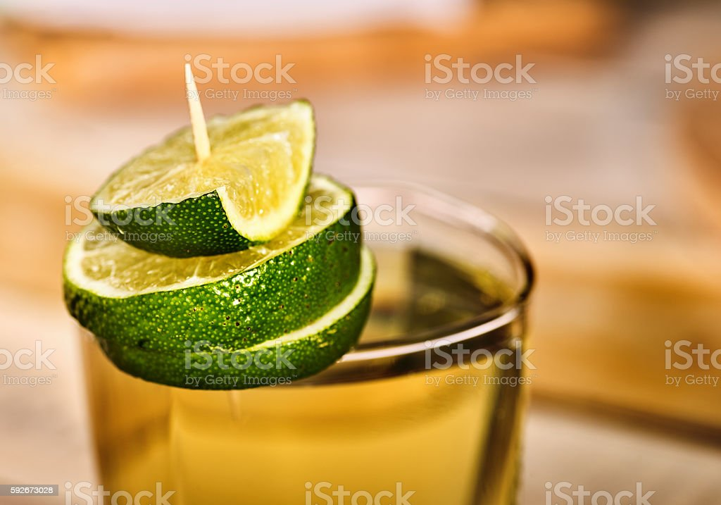 Glass with green transparent cocktail and lime. stock photo