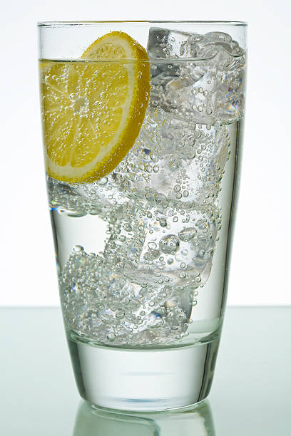 Glass with ice and lemon stock photo