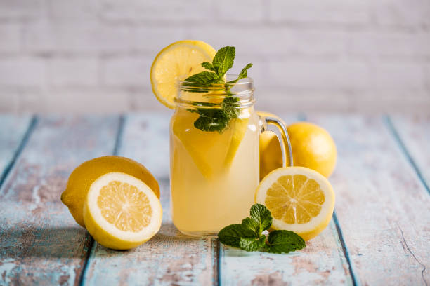 Glass with natural lemon juice Glass with natural lemon juice lemon juice stock pictures, royalty-free photos & images