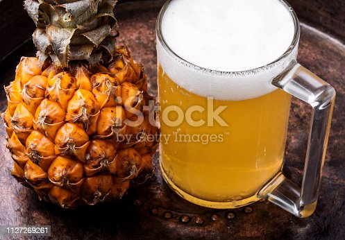 istock Glass with pineapple ale 1127269261