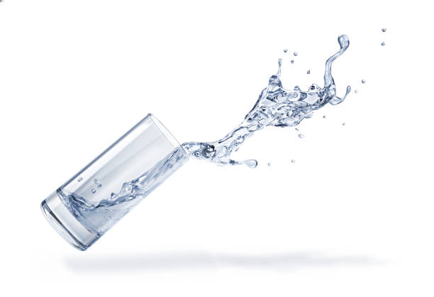 Glass with spilling water splash. Side view. On white background. Glass with spilling water splash. Side view. On white background. Clipping path included. spilling stock pictures, royalty-free photos & images