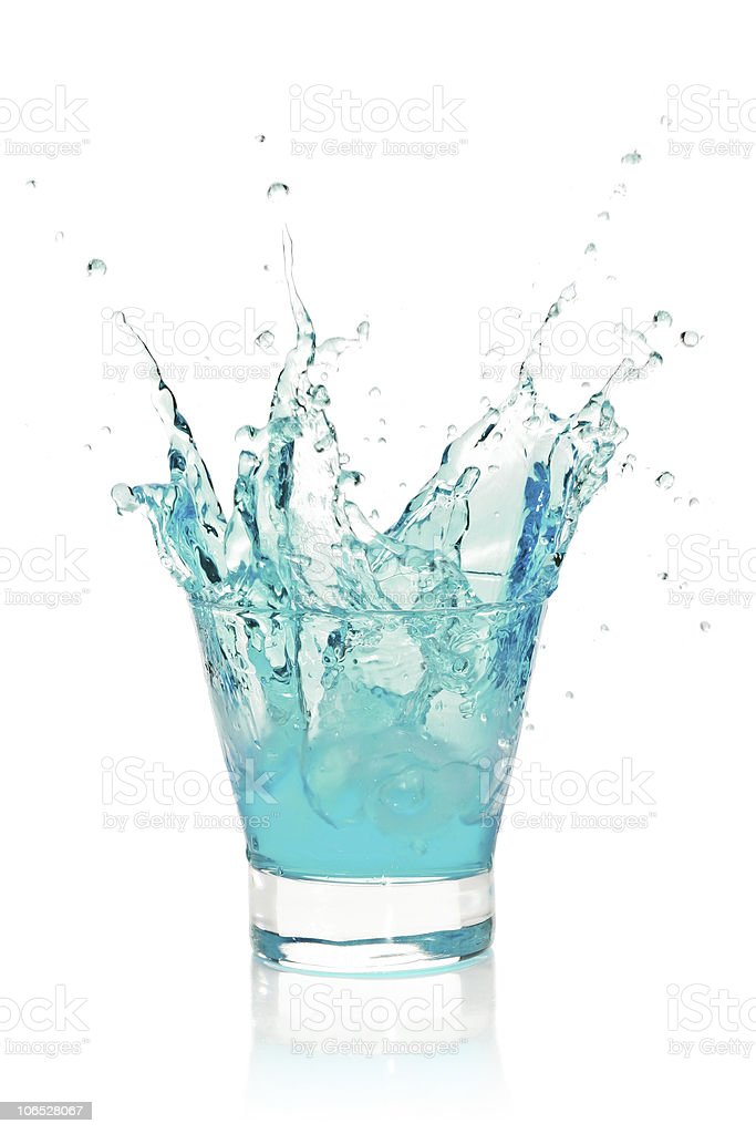 Glass with splashing blue drink royalty-free stock photo