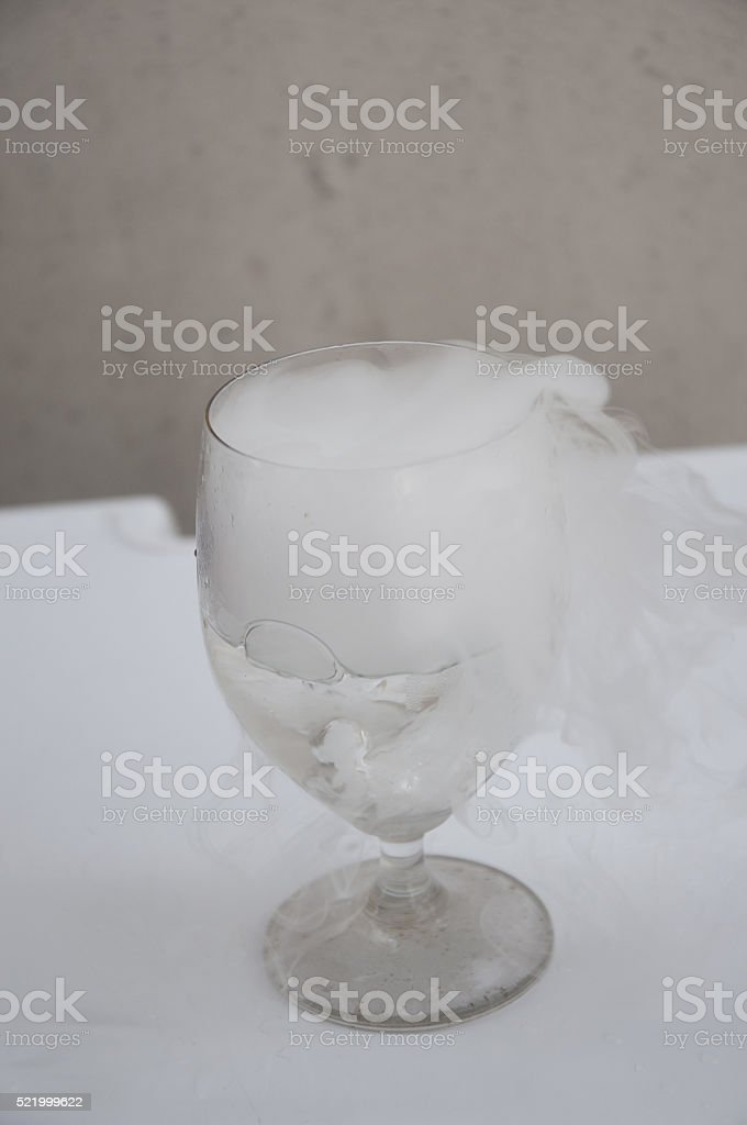 glass with the effect of dry ice stock photo