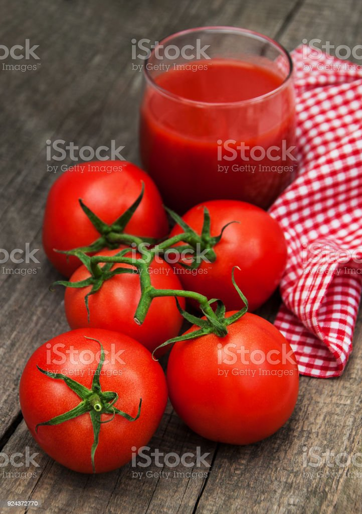 Glass with tomato juice stock photo