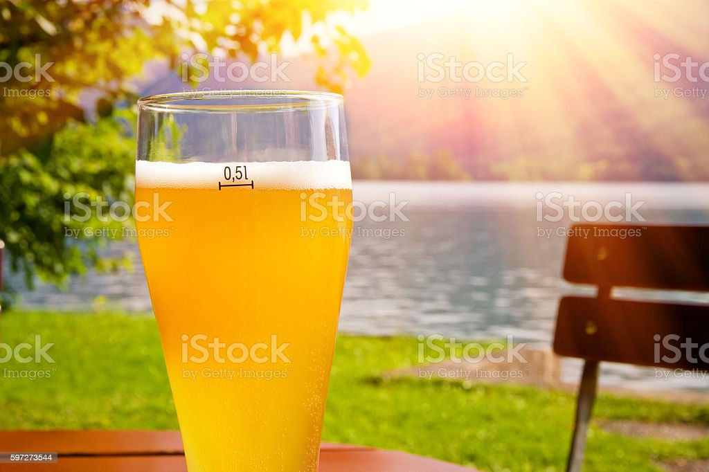 Glass with wheat beer on bavaria in the sun royalty-free stock photo