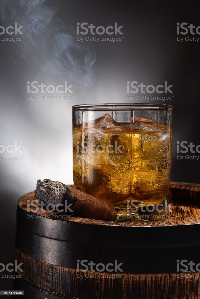Glass with whiskey and cigar stock photo