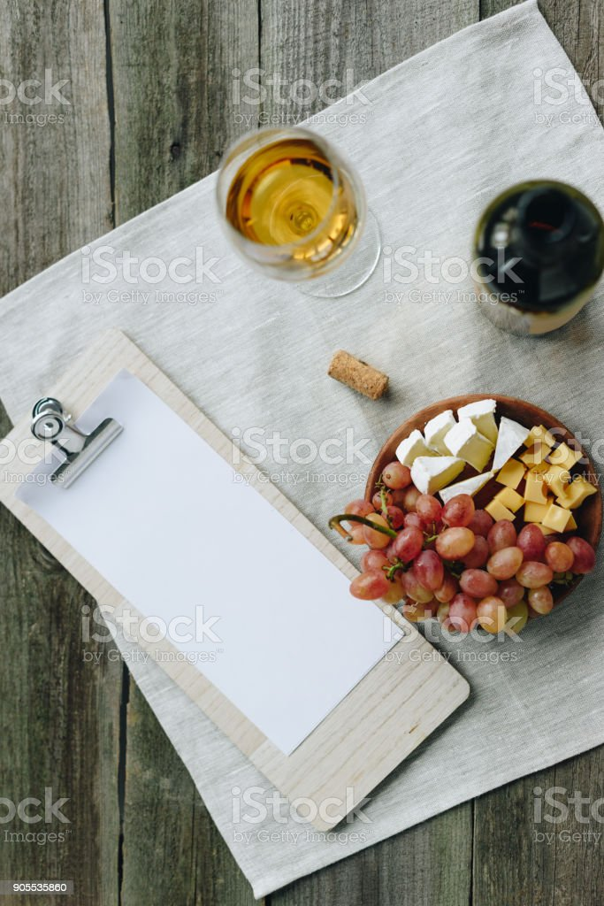 glass with wine and clipboard stock photo
