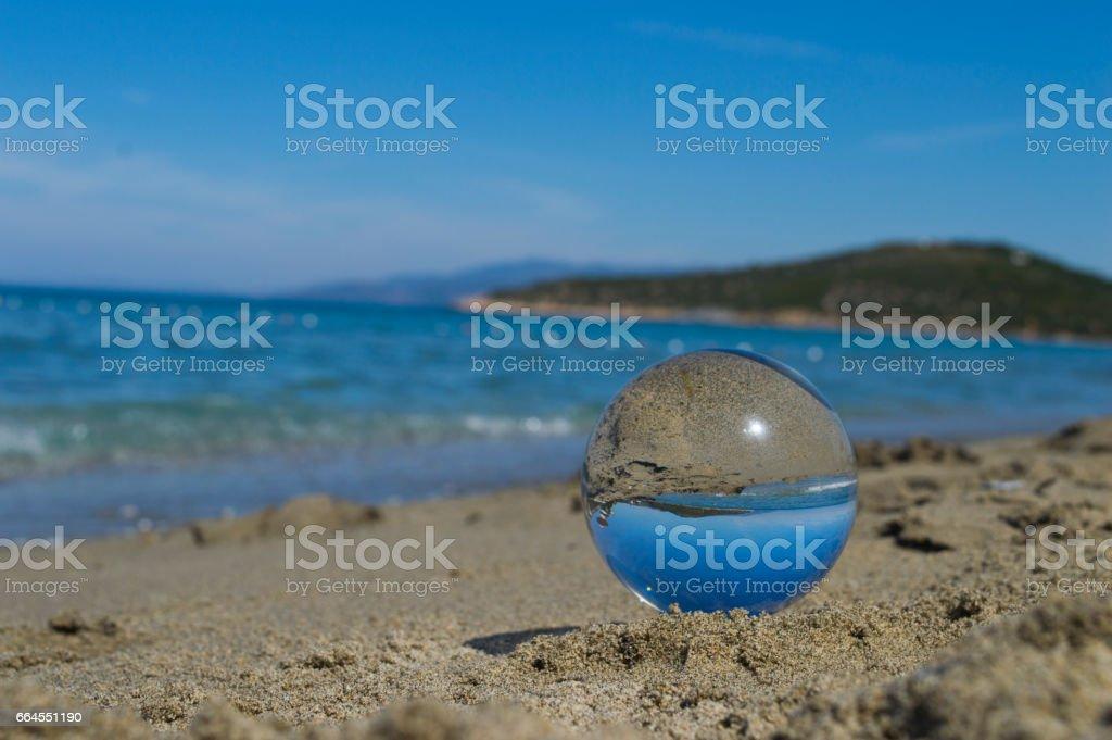 A glassball is on the beach in Kusadasi, Aydin stock photo