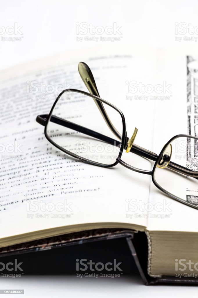 Glasses and a book stock photo