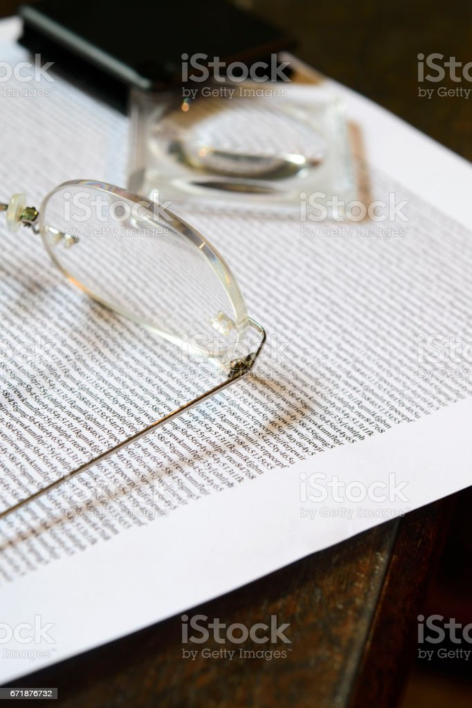 Glasses and a Magnifying Glass stock photo