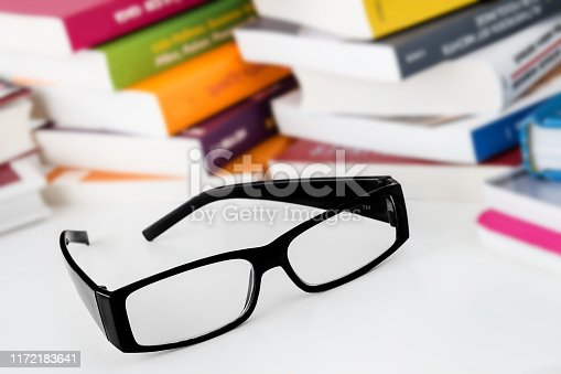 istock Glasses and books 1172183641