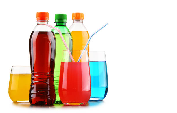 glasses and bottles of assorted carbonated soft drinks - bottle soft drink foto e immagini stock